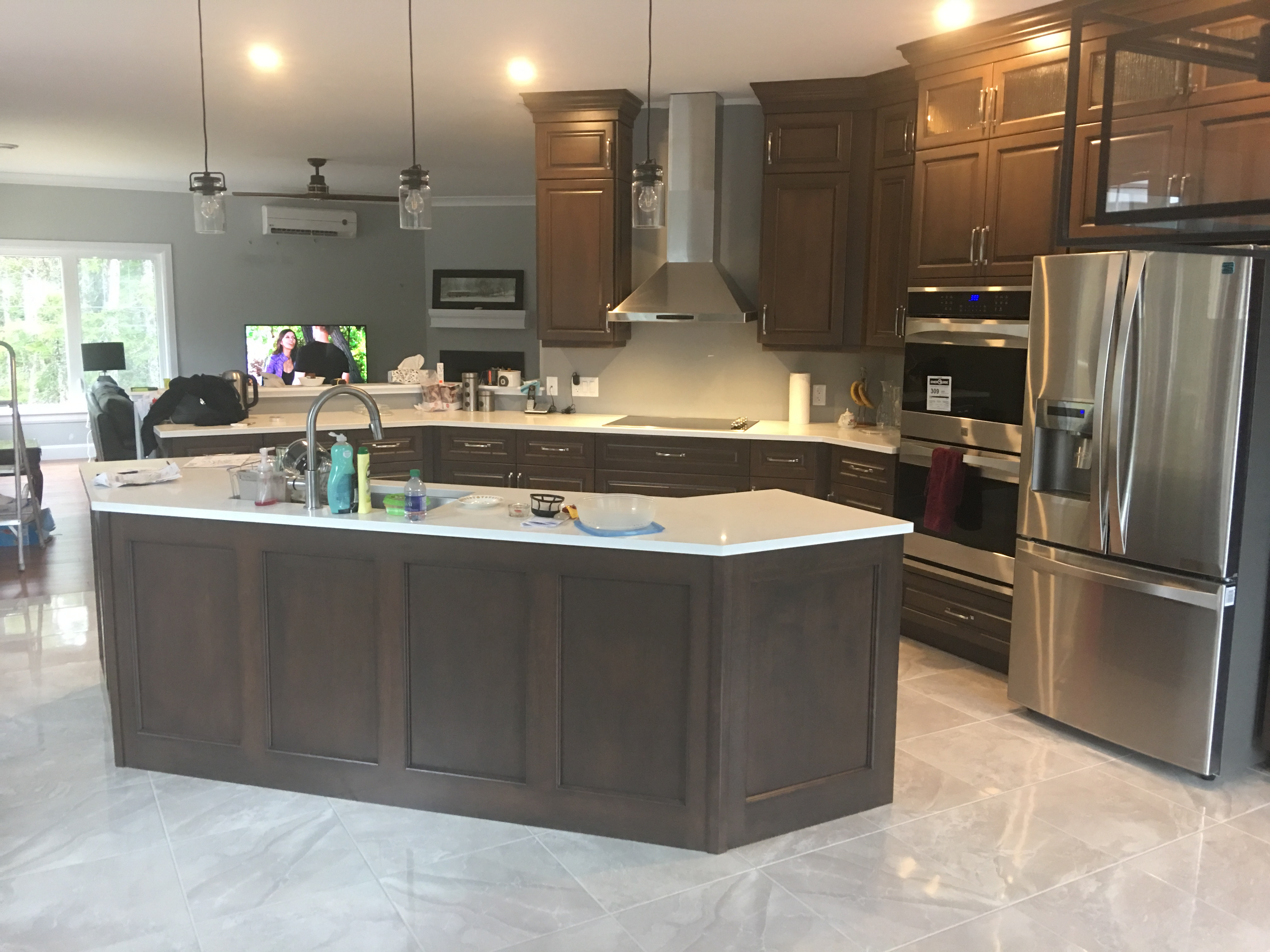 Kitchen with Dark Stain and Quartz Tops - left view
