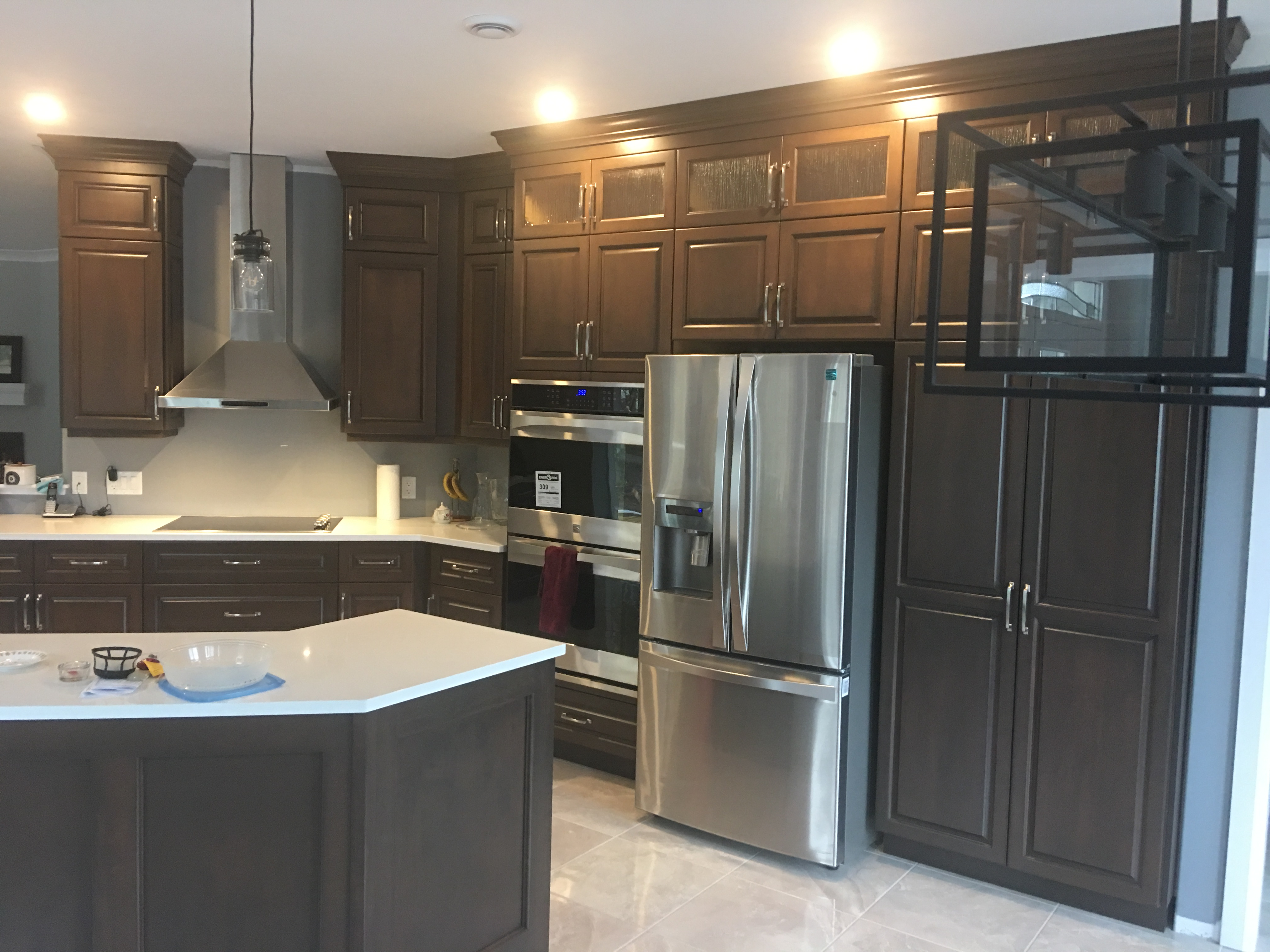 Kitchen with Dark Stain and Quartz Tops - right view
