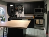 Black PVC Cabinetry with a Solid Birch Bucher Block Top
